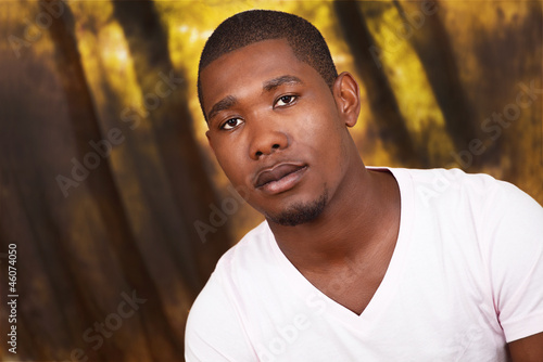Serious african man on grunge background