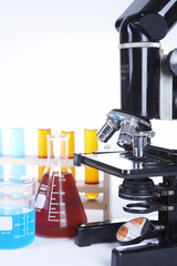 Microscope and other laboratory glassware with reagents