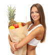 beautiful young woman with fruits in shopping paper bag,