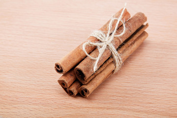 Cinnamon isolated on a wooden background.