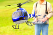 Piloting Radio controlled helicopter with remote control. - 46078898