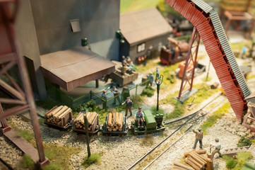 miniature model logging yard and workers