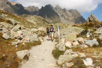 young couple walking in french Alps