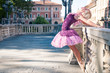 Young beautiful ballerina dancing in Bologna - Pincio, Italy. Ba