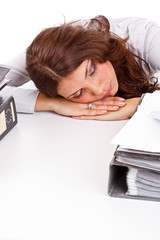 Business woman sleeping while at work
