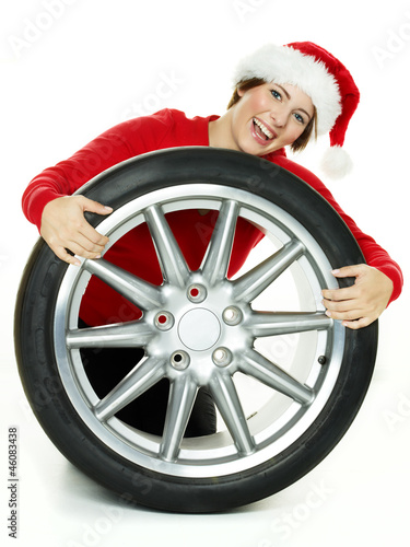Miss santa is playing with her new high performance tyre