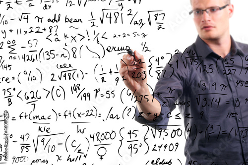 man writes mathematical equations on whiteboard
