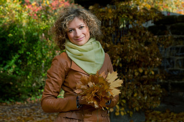 Curly woman in autumn