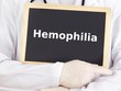 Doctor shows information on blackboard: hemophilia