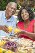 Senior African American Couple Drinking Orange Juice