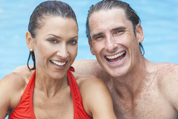 Man & Woman Couple Relaxing In Swimming Pool