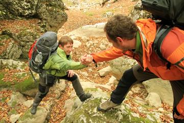 A friend lends a helping hand.