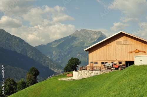 Landscape with wooden agriculture house in Tyrol, Austria.