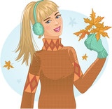 Young woman with autumn maple leaves in hand