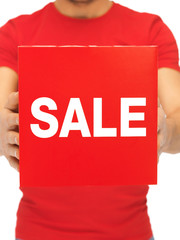 man holding sale sign