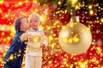 girl kissing sailor under x-mas tree
