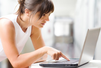 concentrated woman working at laptop