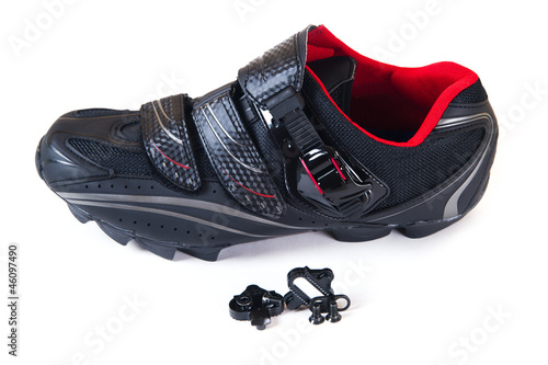 Isolated on white MTB bike shoe and cleat