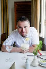 Man enjoying his cocktail