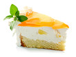 Piece of pineapple cake cream and mint leaves iaolated