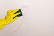 cleaning crayon off wall with sponge