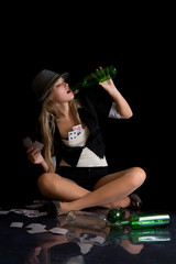 Beautiful womanl with cards and empty bottle