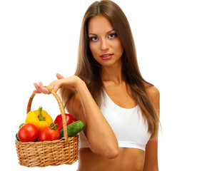 beautiful young woman with vegetables in basket, isolated