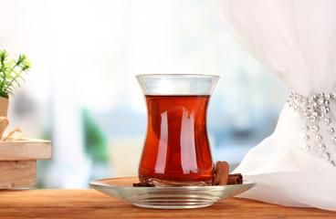 glass of Turkish tea, on wooden table