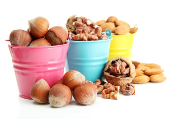 assortment of tasty nuts in pails, isolated on white