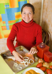 woman is making stuffed fish