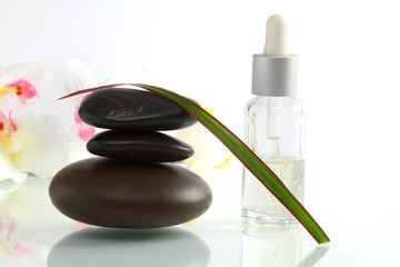 A stack of black stones and spa objects