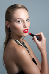 Young woman model with glamour red lips,bright makeup, eye arrow