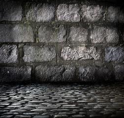 Fond rue et mur en pavé