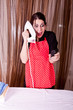 Fanny expression of housewife with cell phone and iron