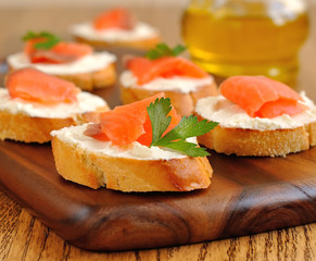 Sandwiches with a salmon on a brown table