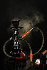 Smoking tools - a hookah, cigar, cigarette and pipe