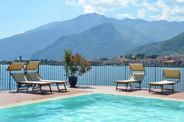 Sunbeds against Como lake, Italy