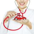 Woman is checking a red car very closely with stethoscope