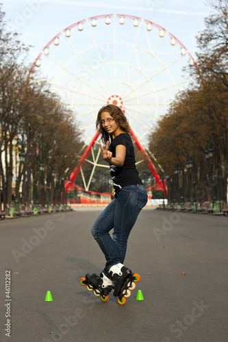 Attractive student rollerblading in summer