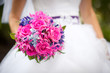 Bride holding bright wedding bouquet