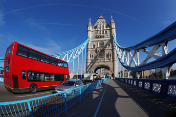 Tower Bridge with red bus in London, UK