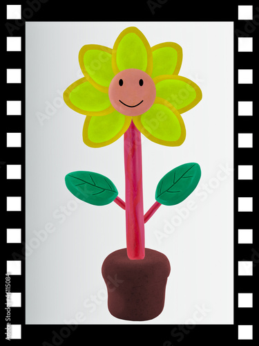 single film strip and smiling flower from clay