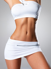 Beautiful female slim tanned body