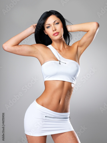 Woman with beautiful slim tanned body