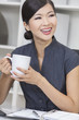 Chinese Asian Woman Businesswoman Drinking Tea or Coffee