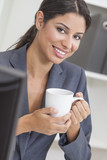 Woman Businesswoman Drinking Coffee in Office
