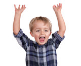 Excited boy with arms raised cheering