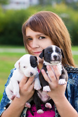 Young Women Holding Two Puppies
