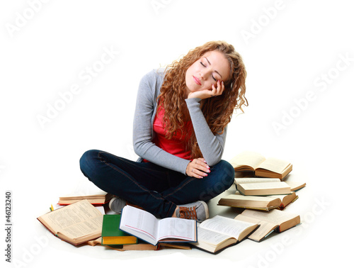 student girl sleeping near books