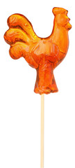 Lollipop in the form of rooster isolated